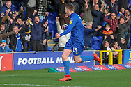 AFC Wimbledon defender Steve Seddon (15), celebrating after scoring goal to make it 1-0 during the EFL Sky Bet League 1 match between AFC Wimbledon and Doncaster Rovers at the Cherry Red Records Stadium, Kingston, England on 9 March 2019.
