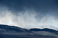 Winter rain showers over desert mountains at Eureka Valley, Death Valley national park, California