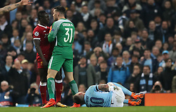 Liverpool's Sadio Mane is confronted by Manchester City goalkeeper Ederson after a challenge on Manchester City's Nicolas Otamendi during the UEFA Champions League, Quarter Final at the Etihad Stadium, Manchester.