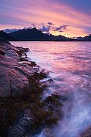 Rugged rocky coastline and mountain view at Stamsund, Vestvågøy, Lofoten islands, Norway