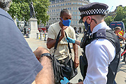 """Police arrest British-African photojournalist Craig Bernard in Trafalgar Square, central London on Sunday, Aug 9, 2020. Bernard was covering a demonstrative action of the environmental activists' group Extinction Rebellion. A Police officer told a member of """"Legal Observers"""" in the scene that among the reason why he was arrested for allegedly committing a quote: """"Affray"""" and riding an uninsured e-scooter. (VXP Photo/ Vudi Xhymshiti)"""