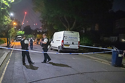 © Licensed to London News Pictures. 01/06/2021. London, UK. Police officers guard a crime scene on Booth Road following a fatal stabbing of an 18-year-old male at Montrose Park, Edgware. Metropolitan Police were called at 17:54 BST on Monday 31/05/2021 following reports of a group of males fighting. The man was found suffering from a stab injury in a tennis court area. He was treated by London's Air Ambulance and London Ambulance Service at the scene but was pronounced dead at 19:19 BST. Photo credit: Peter Manning/LNP