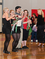 Erica Gilbert from Stages Dance Academy and Liana Gilbert from Platinum Salon & Spa raise the championship trophies for their winning tap performance at Dancing With the Community Stars competition Saturday evening at Laconia Middle School.   (Karen Bobotas/for the Laconia Daily Sun)