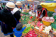 ECUADOR, HIGHLANDS, CANAR Canari Indians in produce market