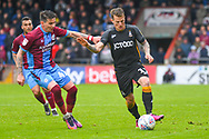 Billy Clarke of Bradford City (17) and Adam Hammill of Scunthorpe United (47) in action during the EFL Sky Bet League 1 match between Scunthorpe United and Bradford City at Glanford Park, Scunthorpe, England on 27 April 2019.