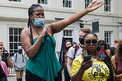 London, UK. 29th May, 2021. A speaker addresses fellow civil rights and other activists outside the British Museum about looted artefacts contained within their collections during a Kill The Bill National Day of Action in protest against the Police, Crime, Sentencing and Courts (PCSC) Bill 2021.
