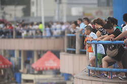 August 3, 2017 - Qingdao, Qingdao, China - Qingdao, CHINA-August 3 2017: (EDITORIAL USE ONLY. CHINA OUT) ..Tourists view high wave caused by typhoon in Qingdao, east China's Shandong Province, August 3rd, 2017. (Credit Image: © SIPA Asia via ZUMA Wire)