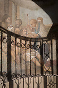 A mural and the shadows of railings on Loretanska street in Hradcany district, on 19th March, 2018, in Prague, the Czech Republic.
