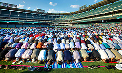 September 1, 2017 - Anaheim, California, U.S. - Muslims celebrate Eid al-Adha with morning prayer at Angel Stadium in Anaheim just after sunrise on Friday. (Credit Image: © Mark Rightmire/The Orange County Register via ZUMA Wire)