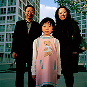 Gao Wen Hong, 41, is CEO of a cosmetics company. Her husband, Wang Wei, also 41, is the director. They have one daughter, Wang YingChen, 7 who is top of the class at her primary school which has the best results in Beijing. Wen Hong says she prefers to have only one child so she can put all her resources into her. ..Its over thirty years (1978) since the Mao's Chinese government brought in the One Child Policy in a bid to control the world's biggest, growing population. It has been successful, in controlling growth, but has led to other problems. E.G. a gender in-balance with a projected 30 million to many boys babies; Labour shortages and a lack of care for the elderly.