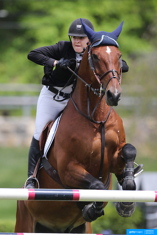 Meredith Darst riding Quester De Virton in action during the $35,000 Grand Prix of North Salem presented by Karina Brez Jewelry during the Old Salem Farm Spring Horse Show, North Salem, New York, USA. 15th May 2015. Photo Tim Clayton
