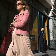 A woman shops at Moscow's Stoleshnikov Lane, home to brands such as Burberry, Louis Vuitton, Vivienne Westwood, Hermes and star Russian designer Deniz Simachev.
