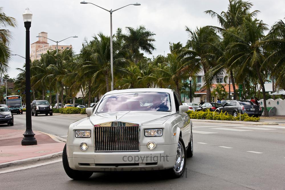 White Rolls Royce Phantom four-door limousine turns off Collins Avenue, South Beach, Miami, USA