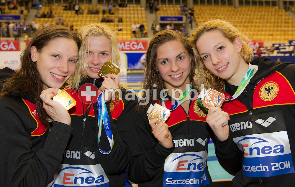 (L-R) Dorothea BRANDT of Germany and her teammates Britta STEFFEN, Paulina SCHMIEDEL and Daniela SCHREIBER pose with their Gold medals after finishing first in the women's 4x50m Freestyle Relay Final during the 15th European Short Course Swimming Championships in Szczecin, Poland, Friday, Dec. 9, 2011. (Photo by Patrick B. Kraemer / MAGICPBK)