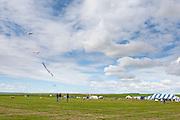 Kites and the Windscape banner. Windscape Kite Festival, Swift Current, Saskatchewan.