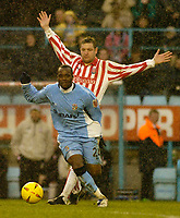Photo. Glyn Thomas. 22/02/2005.<br /> Coventry City v Stoke City. Coca Cola Championship.<br /> Coventry's Stern John (L) slips past Gerry Taggart.
