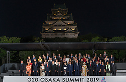 Brigitte Macron, French President Emmanuel Macron, Indonesia's President Joko Widodo, Canada's Prime Minister Justin Trudeau and wife Sophie Gregoire, Donald Tusk, Giuseppe Conte, South Africa's President Cyril Ramaphosa, Spanish Prime Minister, Pedro Sanchez, and his wife Begona Gomez, China's President Xi Jinping, Germany's Chancellor Angela Merkel, Russia's President Vladimir Putin, Saudi Arabia's Crown Prince Mohammed bin Salman, Japan's Prime Minister Shinzo Abe's wife Akie Abe and Japan's Prime Minister Shinzo Abe and UA President Donald Trump, Turkey President Recep Tayyip Erdoğan and his wife during family photo session on the first day of the G20 summit in Osaka, Japan on June 28, 2019. Photo by Jacques Witt/Pool/ABACAPRESS.COM