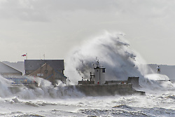 © Licensed to London News Pictures. 21/08/2020. Porthcawl, Bridgend, Wales, UK. Gale force winds and massive waves batter the small Welsh seaside resort of Porthcawl in Bridgend, UK. Photo credit: Graham M. Lawrence/LNP