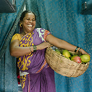 Peddler selling mangoes. <br /> Life on the longest train ride in India, between Kanyakumari and Dibrugarh city.