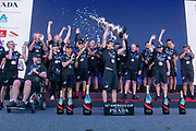 Peter Burling with the Cup. Emirates Team New Zealand celebrate on stage after being presented with the Americas Cup on stage after beating Luna Rossa Prada Pirelli Team 7 - 3. Glen Ashby pours for Peter Burling.  Wednesday the 17th of March 2021. Copyright photo: Chris Cameron
