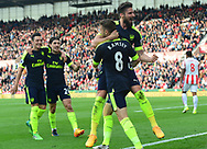 Olivier Giroud of Arsenal celebrates with Aaron Ramsey after he scores his teams 4th goal. Premier league match, Stoke City v Arsenal at the Bet365 Stadium in Stoke on Trent, Staffs on Saturday 13th May 2017.<br /> pic by Bradley Collyer, Andrew Orchard sports photography.