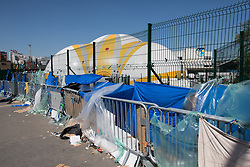 © Licensed to London News Pictures . 09/05/2017. Paris, France . The Porte de la Chapelle immigration centre , adjacent to the scene where French police have cleared approximately 1000 people from an ad hoc roadside camp under roadways along a central reservation , in which migrants were living , in Porte de la Chapelle in North Paris , this morning (9th May 2017) . Photo credit: Joel Goodman/LNP