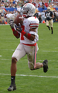Ted Ginn pulls in a 65-yard pass from Troy Smith last night in the first quarter of the Fiesta Bowl.