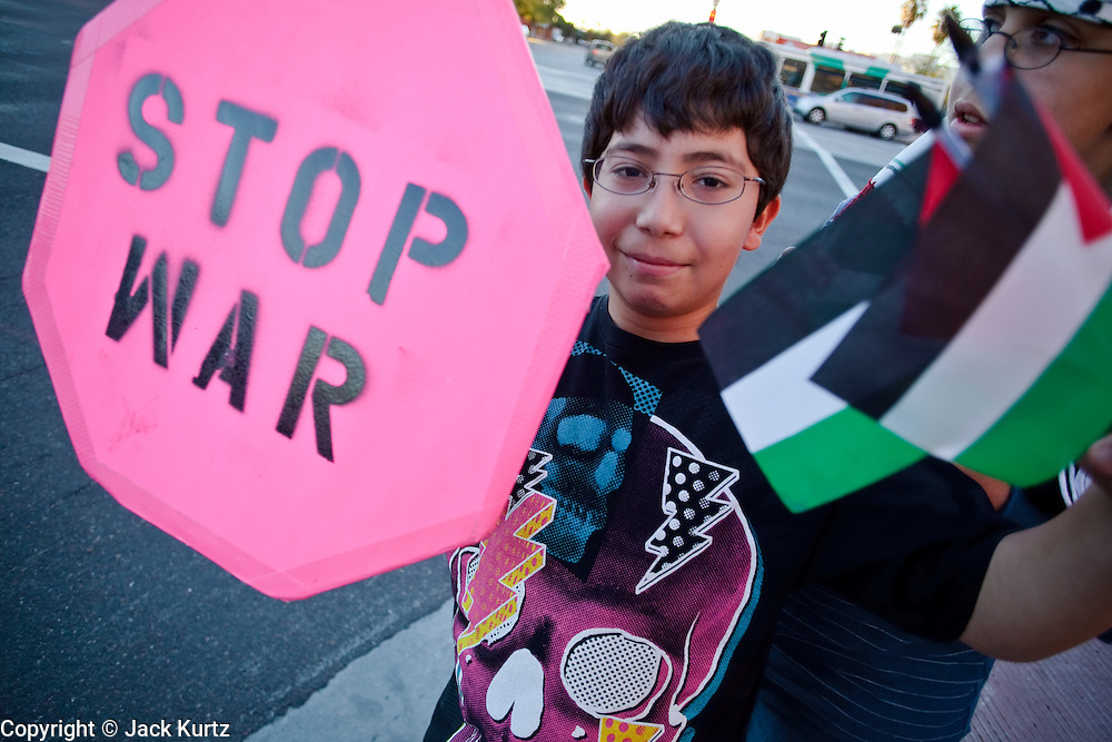 30 DECEMBER 2008 -- PHOENIX, AZ: Palestinian-American boys in Phoenix march in opposition to the Israeli attacks on Gaza Tuesday. About 200 people from a variety of human rights and peace activists organizations in Phoenix, AZ, marched in opposition to the Israeli attacks on Gaza and in favor of Palestinian rights on Tuesday, the fourth day of Israeli air strikes on Hamas facilities in Gaza. Photo by Jack Kurtz / ZUMA Press