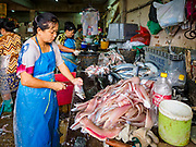19 JULY 2018 - BANGKOK, THAILAND: Workers cut up fish to make fish balls and fish sausage in the Saphan Pla Fish Market in Bangkok. Fish consumption recently hit a record high according to a report published recently by the United Nations Food and Agriculture Organization. The FAO reported that global fish production peaked at about 171 million tonnes in 2016, 47 percent of it from fish farming. The FAO also reported that global fish consumption between 1961 and 2016 was rose nearly twice as fast as population growth. In 2015, fish accounted for about 17 percent of the animal protein consumed globally. This has ramifications for Thailand, which has one of the world's largest fish and seafood industries. About 90% of Thailand's seafood production is exported, which accounts for about 4% of Thailand's exports.       PHOTO BY JACK KURTZ