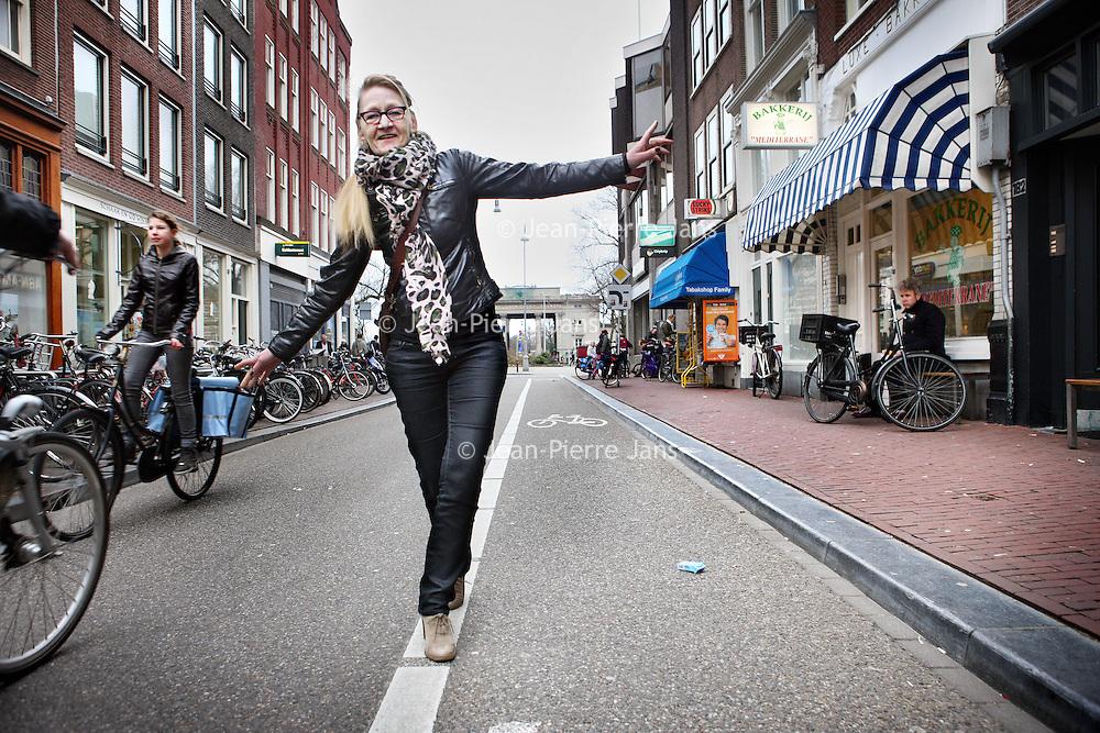 Nederland, Amsterdam , 13 maart 2012..Nel de Jager, Straatmanager hier in de Haarlemmerdijk met op de achtergrond de Haarlemmerpoort..Foto:Jean-Pierre Jans