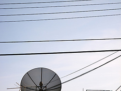 Power lines and antennae fill the sky