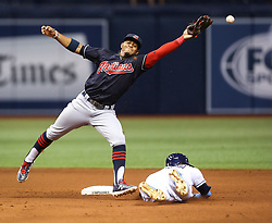 August 10, 2017 - St. Petersburg, Florida, U.S. - WILL VRAGOVIC       Times.Tampa Bay Rays shortstop Adeiny Hechavarria (11) safe stealing second, advances to third on the error as Cleveland Indians shortstop Francisco Lindor (12) can't make the grab on the throw in the eighth inning of the game between the Cleveland Indians and the Tampa Bay Rays at Tropicana Field in St. Petersburg, Fla. on Thursday, August 10, 2017. The Tampa Bay Rays beat the Cleveland Indians 4-1. (Credit Image: © Will Vragovic/Tampa Bay Times via ZUMA Wire)