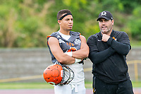 KELOWNA, BC - SEPTEMBER 22:  Head coach Jamie Boreham stands on the field during warm up with Trey Adams #4 of Okanagan Sun against the Valley Huskers at the Apple Bowl on September 22, 2019 in Kelowna, Canada. (Photo by Marissa Baecker/Shoot the Breeze)