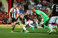 Nottingham Forest midfielder Ben Osborn (11) with a shot during the EFL Sky Bet Championship match between Brentford and Nottingham Forest at Griffin Park, London, England on 16 August 2016. Photo by Matthew Redman.