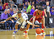 DaJuan Gordon #3 of the Kansas State Wildcats reaches in for a loose ball against Prentiss Nixon #11 of the Iowa State Cyclones during the second half at Bramlage Coliseum on March 7, 2020 in Manhattan, Kansas.