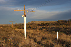Telephone lines in landscape, Terrell County, Texas.