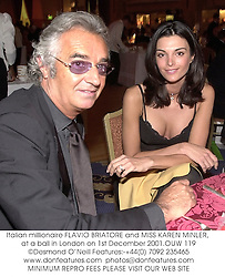 Italian millionaire FLAVIO BRIATORE and MISS KAREN MINLER, at a ball in London on 1st December 2001.OUW 119