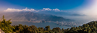 Panoramic view from the World Peace Pagoda above Pokhara, Nepal to peaks of the Annapurna Massif of the Himalayas.