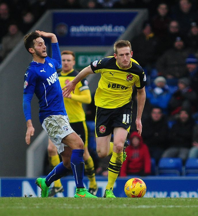 Fleetwood Town's Jeff Hughes under pressure from Chesterfield's Oliver Banks<br /> <br /> Photographer Chris Vaughan/CameraSport<br /> <br /> Football - The Football League Sky Bet League One - Chesterfield v Fleetwood Town - Saturday 28th February 2015 - Proact Stadium - Chesterfield<br /> <br /> © CameraSport - 43 Linden Ave. Countesthorpe. Leicester. England. LE8 5PG - Tel: +44 (0) 116 277 4147 - admin@camerasport.com - www.camerasport.com