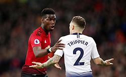 Manchester United's Paul Pogba exchanges words with Tottenham Hotspur's Kieran Trippier