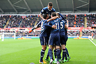 Tottenham's Gareth Bale celebrates with teammates after he scores his sides 2nd goal . Barclays Premier League, Swansea city v Tottenham Hotspur at the Liberty Stadium in Swansea, South Wales on Saturday 30th March 2013. pic by Andrew Orchard, Andrew Orchard sports photography,