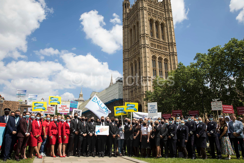 Several hundred representatives of the UKs travel industry gather outside the Houses of Parliament during a day of action intended to apply pressure on the government to reopen the travel sector and to give financial support to travel businesses on 23rd June 2021 in London, United Kingdom. Pilots, cabin crew and travel agents accused the government of failing to restart travel by undermining its Covid-19 traffic light system, which currently does not include viable major tourist destinations on the quarantine-free green list.