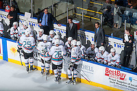 KELOWNA, CANADA - JANUARY 2: Scott Hoyer, athletic therapist, Kris Mallet, assistant coach, Brad Ralph, head coach, Travis Cricked, assistant coach and Chaydyn Johnson, equipment manager stand on the bench during the time out with the Kelowna Rockets against the Victoria Royals on January 2, 2016 at Prospera Place in Kelowna, British Columbia, Canada.  (Photo by Marissa Baecker/Shoot the Breeze)  *** Local Caption *** Scott Hoyer; Kris Mallet; Brad Ralph; Travis Cricked; Chaydyn Johnson;