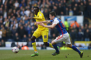 Toumani Diagouraga of Leeds United and Darragh Lenihan of Blackburn Rovers chase the ball. Skybet football league Championship match, Blackburn Rovers v Leeds United at Ewood Park in Blackburn, Lancs on Saturday 12th March 2016.<br /> pic by Chris Stading, Andrew Orchard sports photography.