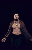 Sexy Spiritual South American man beautifully adorned photographed in black and white sepia tone.