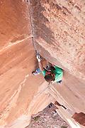"Brad Parker climbing ""Anasazi,"" a 5.11b crack route at Indian Creek, near Moab, Utah"