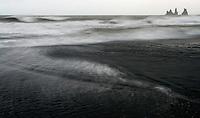 16.06.2008.The sea stacks of Reynisdrangar at Vik in storm.Iceland