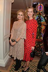 Left to right, LAURA BAILEY and EVA HERZIGOVA at the Claridge's Christmas Tree By Dolce & Gabbana Launch Party held at Claridge's, Brook Street, London on 26th November 2013.