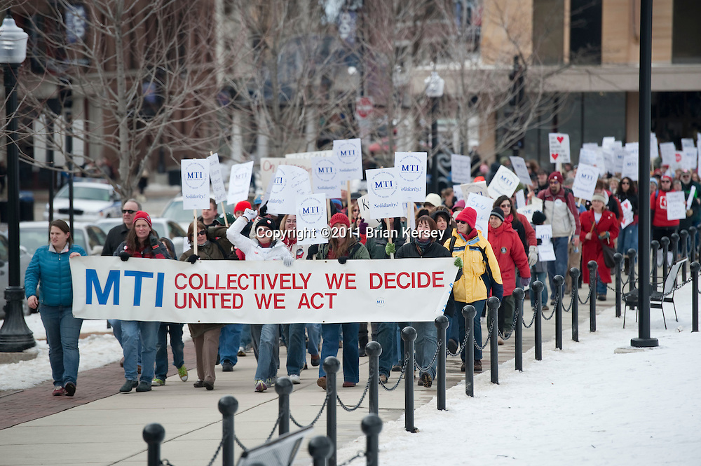 Teachers march outside of the state Capitol in Madison, Wisconsin on February 25, 2011. Protests over budget legislation continued at the state Capitol for the 11th day.      (Photo by Brian Kersey)