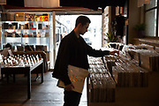 A man searching for records in Phonica record shop on Poland Street, Soho, on the 23rd March 2018 in Central London, United Kingdom